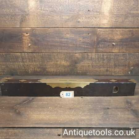 """Lot 82Very unusual ornate 27"""" rosewood and brass spirit level"""
